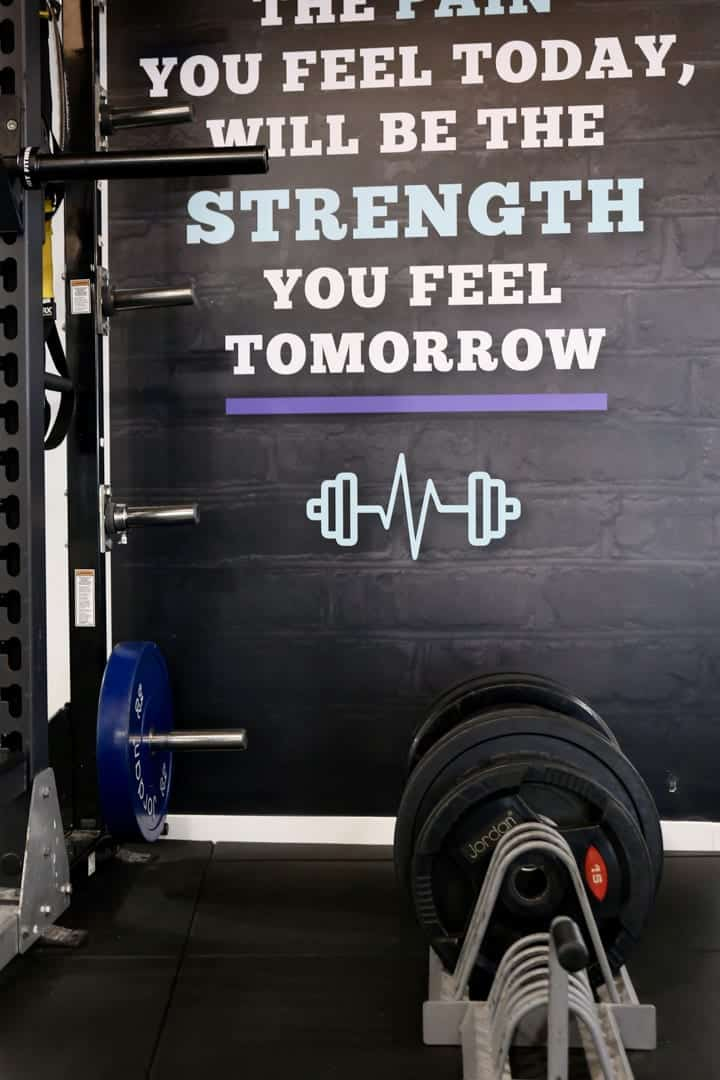 Osprey Hotel Gym Quote Protrait with Weights infront